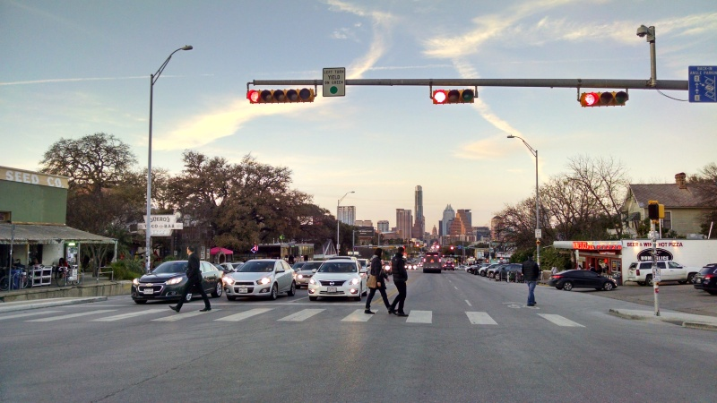 View from middle of the over wide stroad, South Congress Avenue looking toward the city.