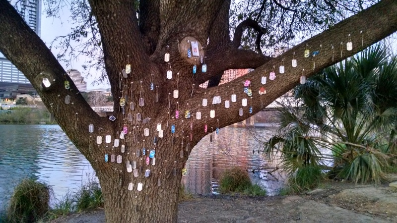 View of installation artwork dedicated to the lives lost of people living on the street in Austin, along the Butler Hike and Bike Trail.