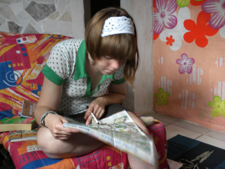 Checking out a map of Salvador, Brazil in 2010 in a hostel before heading out to explore.