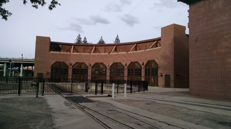 Back side of the California State Railroad Museum, showing a historic railway turntable and train garage.