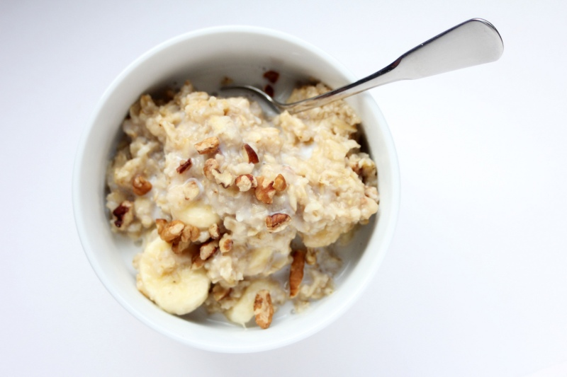 Oatmeal, pecans, sliced banana, and maple syrup packet in a cup courtesy of Rachel Hathaway.