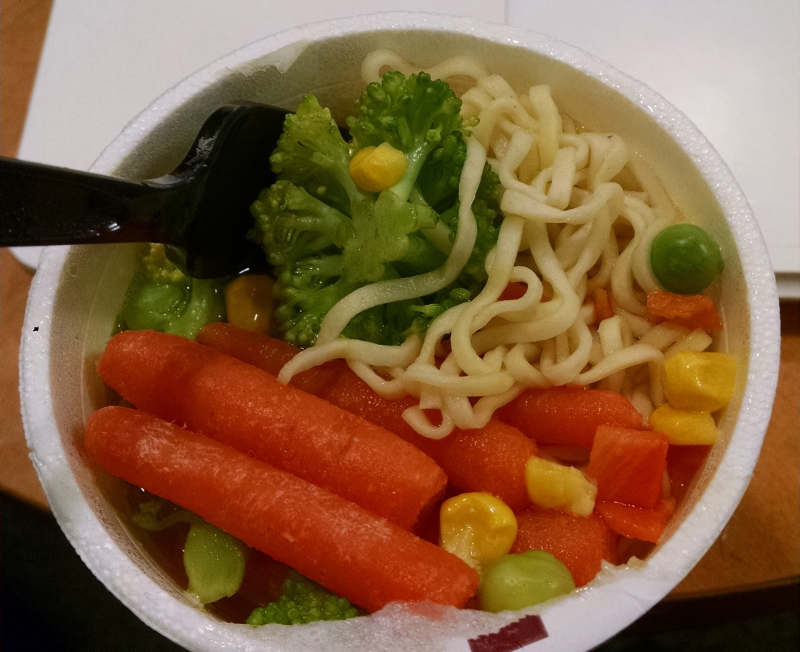 Cup of noodles with al dente veggies that I ate for dinner while commuting home from JFK to LAX after finishing up a four-day trip.