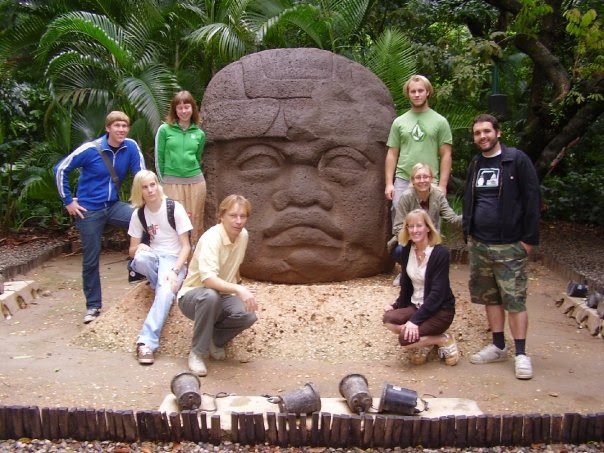 the whole family with an olmec head